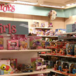 Toy department with separate 'Boys' and 'Girls' shelves.