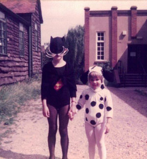 Children dressed up as a cat and a spotty dog.