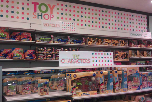 After: In October 2013 Debenhams announced the would change toy departments with inclusive colours and thematic shelving.  (Cork, November 2013)