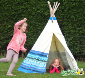 Girls playing in wigwam