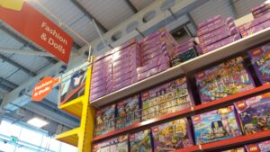 Toy shelves - Lego Friends building sets under a 'Fashion and dolls' sign