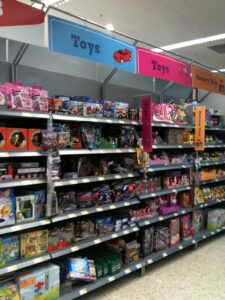 Morrisons blue and pink 'Toys' signs