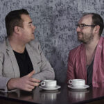 two men chatting over coffee